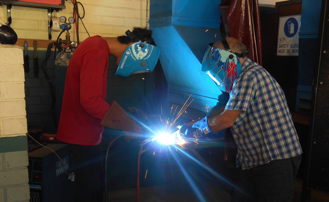 2 students welding