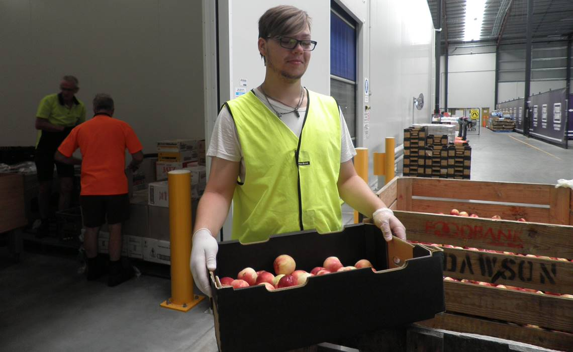 student working at foodbank.